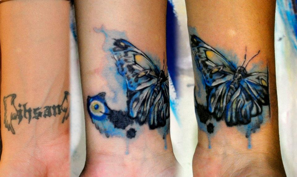 Watercolor butterfly foot tattoo