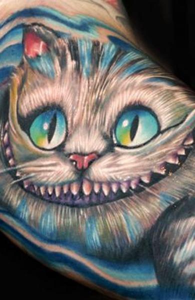 Тату улыбок чеширского кота