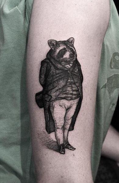фото татуировка енот