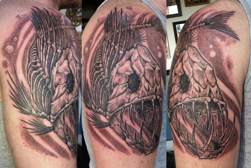 Татуировка скелет рыбы
