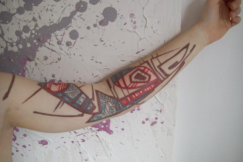 Татуировка от Григория Маслова на руке