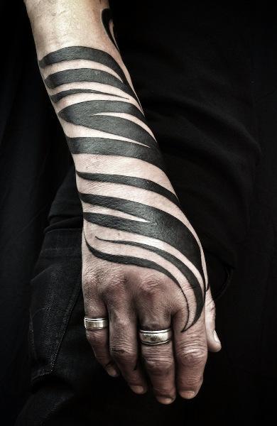 Татуировка в стиле трайбл